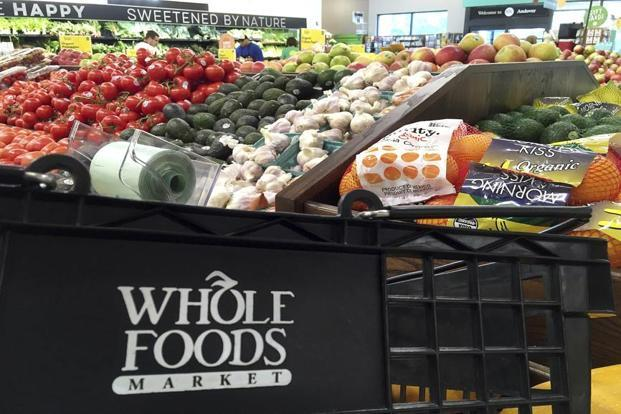 Whole Foods can help by giving Amazon a better understanding of what people do at physical retail stores, where 90% of worldwide retail spending still happens. Photo: AP