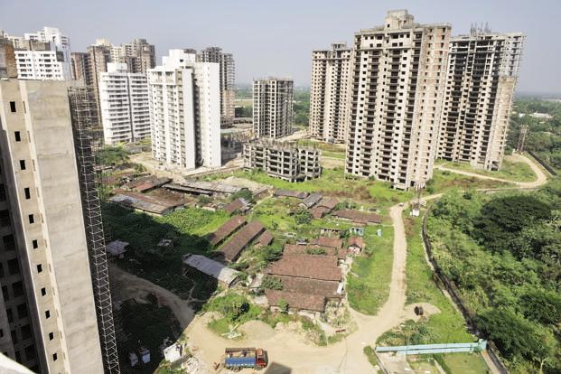 A prolonged slump in real estate has forced realty firms to join hands with land owners and co-develop projects. Photo: Mint