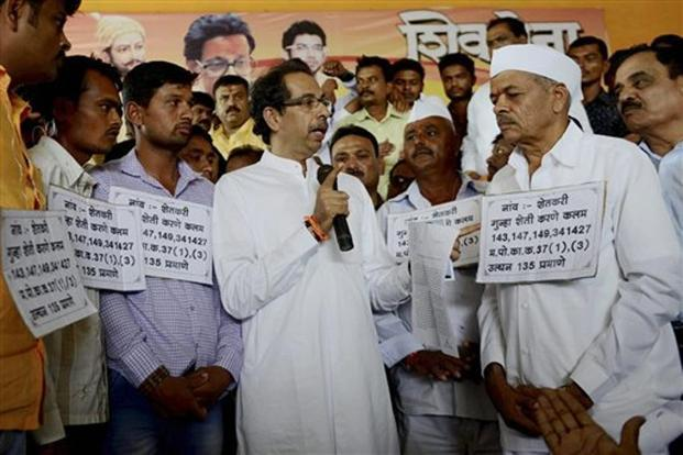 Shiv Sena chief Uddhav Thackeray (in centre) has asked the state government to publish names of all 4 million farmers who it claims would have their loans completely waived. Photo: PTI