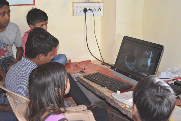 Children watching a movie at the community information research centre in Baran in Rajasthan.