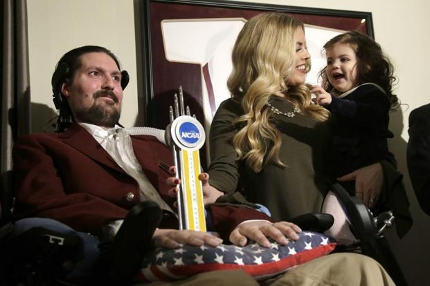 File photo of Pete Frates (L) with his wife and daughter. Frates was diagnosed with amyotrophic lateral sclerosis (ALS) in 2012, and there is no known cure for the disease. Photo: AP