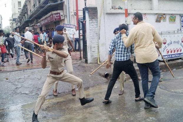 Police lathicharge textile traders who were staging a protest against the goods and services tax (GST) in Surat, on Monday. Photo: PTI