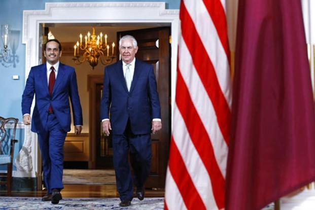 Secretary of state Rex Tillerson walks with ‎Qatari foreign minister Sheikh Mohammed bin Abdul Rahman Al Thani at the state department in Washington. File photo: AP