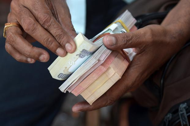 In a survey released by Transparency International, among 16 countries of the Asia-Pacific region, India has the highest bribery rate of 69%. Photo: AFP