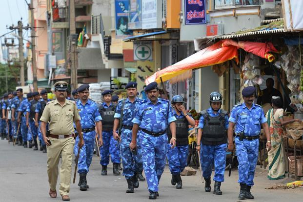 Above, the Rapid Action Force personnel patrol amid tightened security in Karnataka. Photo: AFP