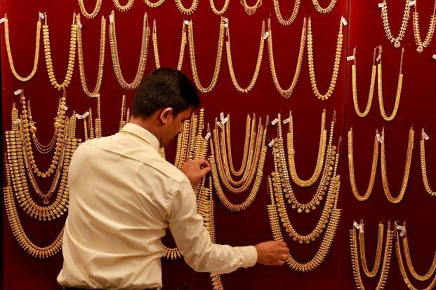 Gold prices fell to a six-week low of Rs28,135 in Wednesday's bullion trade following subdued demand from stockists and retailers. Photo: Reuters