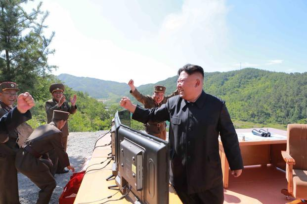 North Korean Leader Kim Jong Un reacts during the test-fire of ICBM Hwasong-14 in this undated photo released by Korean Central News Agency (KCNA) in Pyongyang on 4 July 2017. Photo: KCNA/via Reuters