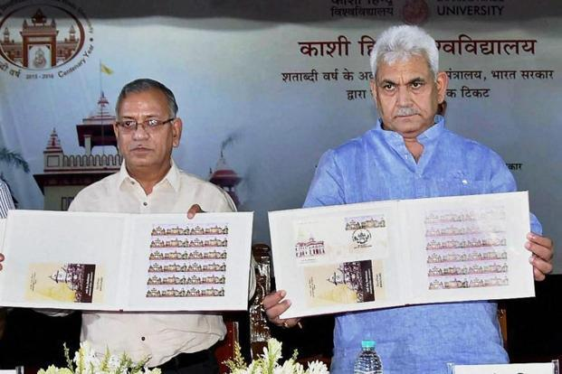 Telecom minister Manoj Sinha releasing a commemorative postage stamp on the occasion of centenary year celebrations of Kashi Hindu University, in Varanasi on Wednesday. Photo: PTI