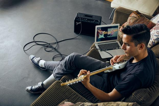 A young man uses 'Fender Play', a new subscription-based digital learning programme from Fender with instructor-guided video lessons. Photo: Reuters