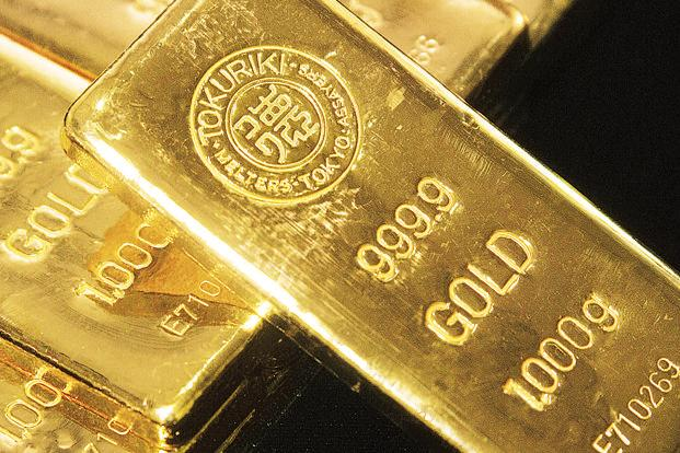 Globally, gold prices fell 0.27% to $1,223.40 an ounce and silver by 0.56% to $15.98 an ounce in Singapore.  Photo: Bloomberg