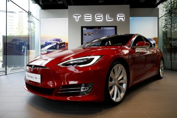 The seat belt in Tesla's Model S was not effective and could lead to the driver's head striking the steering wheel hard through the air bag. Photo: Reuters