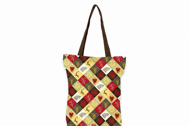 This smart canvas tote bag from Redwolf is patterned with the different house sigils.
