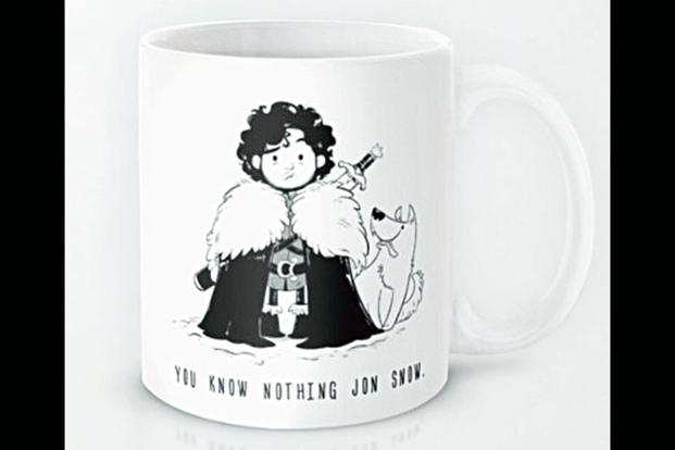 "This coffee mug illustrates its ""You know nothing Jon Snow"" legend with a forlorn caricature."