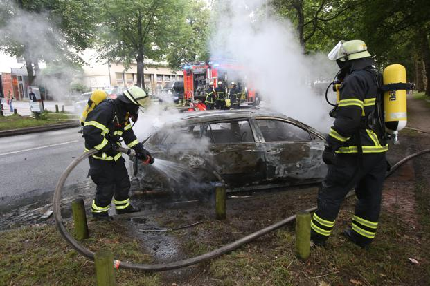 German TV on Friday showed several cars burning in the Altona area and about 100 demonstrators sitting on the street that US President Donald Trump is set to use to reach the gathering. Photo: AP