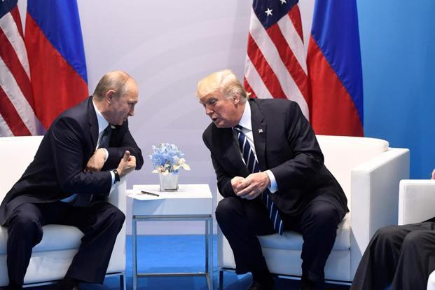 US President Donald Trump and Russia's President Vladimir Putin hold a meeting on the sidelines of the G20 Summit in Hamburg, Germany, on 7 July. Photo: Saul Loeb/AFP