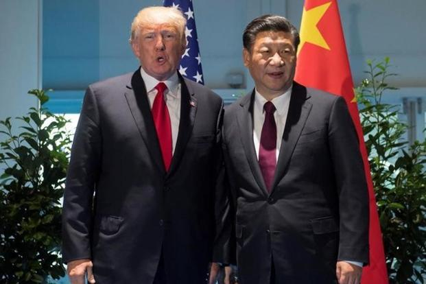US President Donald Trump and Chinese President Xi Jinping (right) meet on the sidelines of the G20 Summit in Hamburg, Germany, on Saturday. Photo: Saul Loeb/Reuters