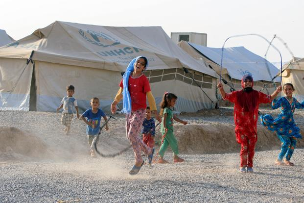Displaced children play with ropes in Hassan Sham Camp, east of Mosul, Iraq on Friday. Photo: Alaa al-Marjani/Reuters