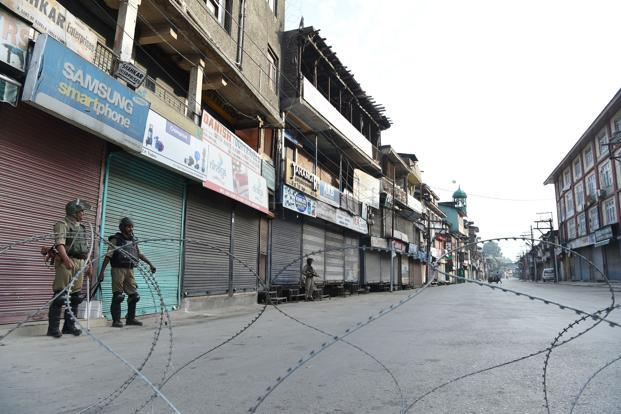 Paramilitary troopers patrol during a curfew in Srinagar on 8