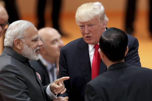 Prime Minister Narendra Modi and US President Donald Trump during the G-20 Summit on Saturday. Photo: PTI