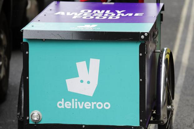 Unions have sharply criticized the report, describing it as a lost opportunity to address inequity and a feeble response to the growing number of workers in delivery and ride-hailing firms such as Deliveroo and Uber. Photo: AP