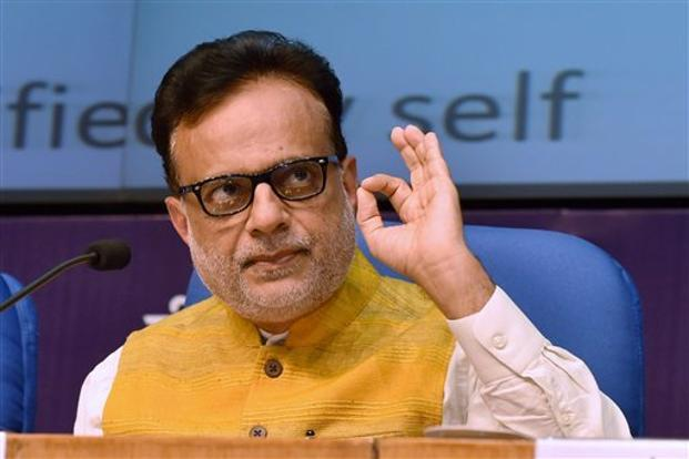 Hasmuk Adhia has said that GST will be levied on entire sum of food bill, including service charge, in a restaurant, while the value of alcohol or alcohol products consumed will attract VAT. Photo: PTI