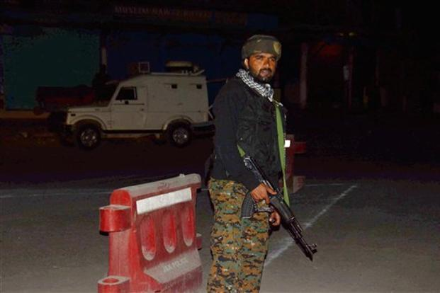 A security personnel stands guard after militants opened fire on the Amarnath Yatra in Anantnag, Jammu and Kashmir, on Monday. Photo: PTI