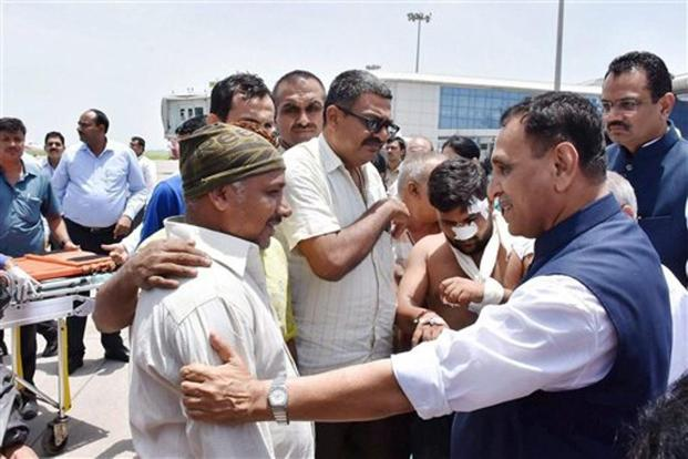 Gujarat chief minister Vijay Rupani meets with the Amarnath pilgrims, who were injured in the terror strike in Jammu and Kashmir, after they were brought to Surat airport in an IAF plane on Tuesday. Photo: