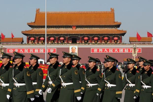 The number of troops in the PLA Navy, PLA Strategic Support Force and the PLA Rocket Force will be increased, while the PLA Air Force's active service personnel will remain the same. Photo: Bloomberg