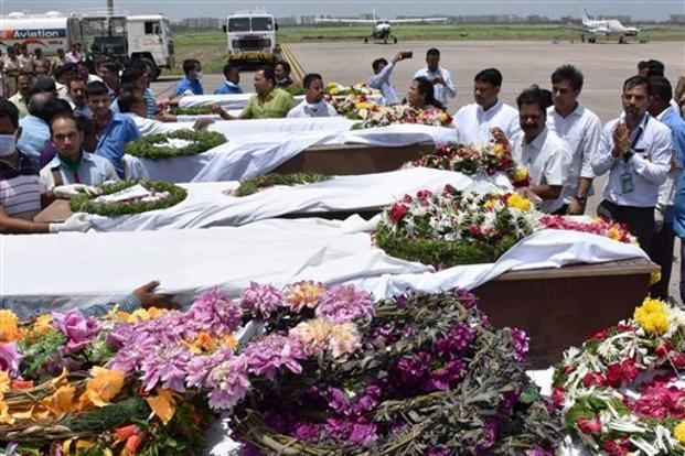 People pay tributes to Amarnath pilgrims who were killed in Monday's militant attack at Anantnag in Jammu and Kashmir, after their bodies were brought in an IAF plane at the airport in Surat on Tuesday. Photo: PTI