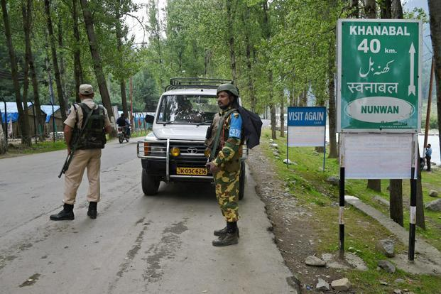 Security personnel guard near Nunwan base camp for Amarnath pilgrims, on Tuesday. Photo: PTI
