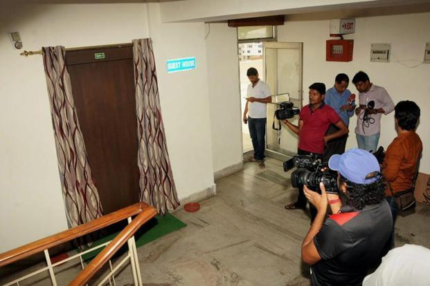 Media persons waiting outside the guest house of principal commissioner of income tax (Jharkhand) Tapas Kumar Dutta following raids by the Central Bureau of Investigation (CBI) in Ranchi on Wednesday. Photo: PTI