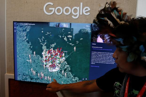 "A Brazilian indigenous from the Surui-Paiter tribe introduces ""I am the Amazon"" during the presentation of the new Google Earth project in Sao Paulo on 11 July. Photo: Reuters"