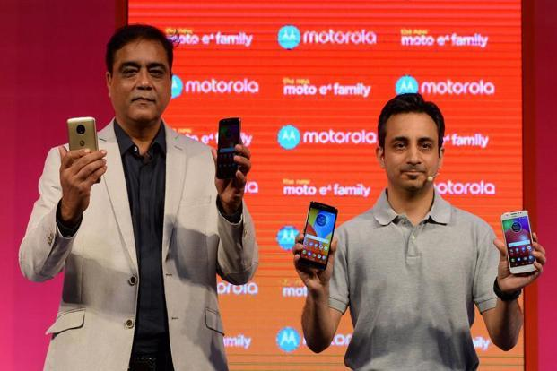 MD Motorola Mobility India Sudhin Mathur (left) and product marketing head for Lenovo MBG Anuj Sharma hold up the newly launched Lenovo-owned Motorola Moto E4plus and Moto E4 smartphones at a promotional event in New Delhi on 12 July.  Photo: AFP