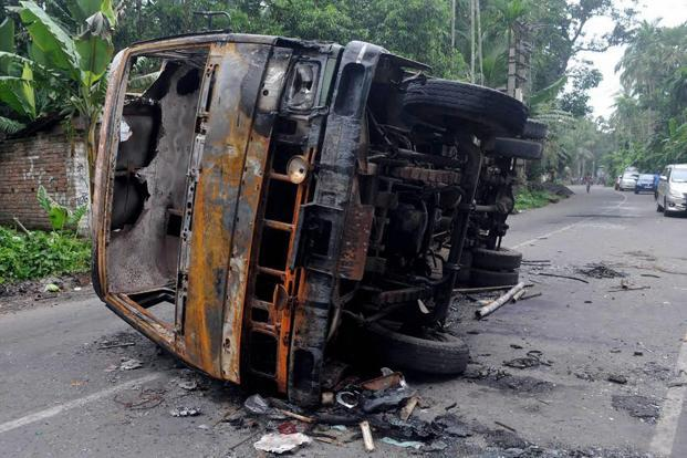 A burnt vehicle seen at a road after a communal riot last week at Baduria in North 24 Parganas district of West Bengal. Photo: PTI