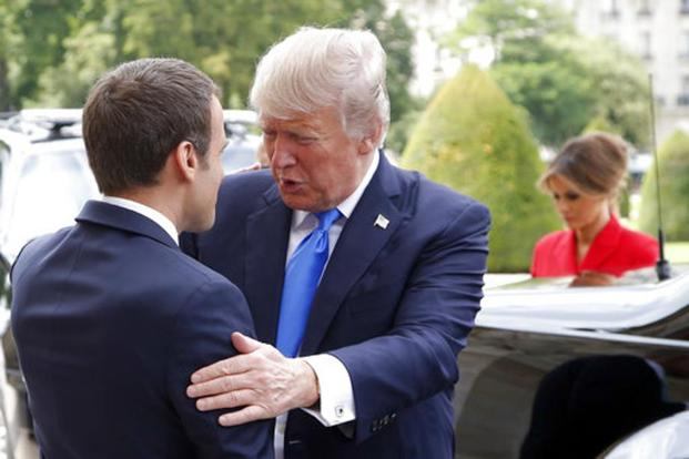 Emmaneul Macron and Donald Trump are scheduled to hold talks lasting an hour and a half before dining with their wives at a restaurant on the second floor of the Eiffel Tower. Photo: AP
