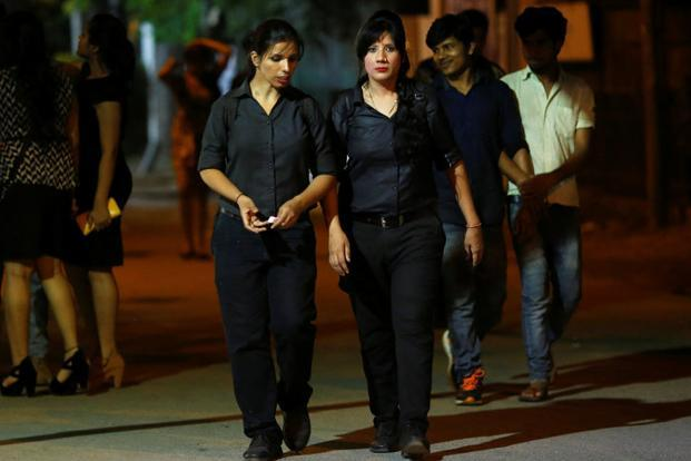 Bouncer Mehrunnisha Shokat Ali (right) and her sister Tarannum walk towards taxi after finishing their shift at the clubs where they work, in New Delhi on 2 June 2017. Photo: Reuters