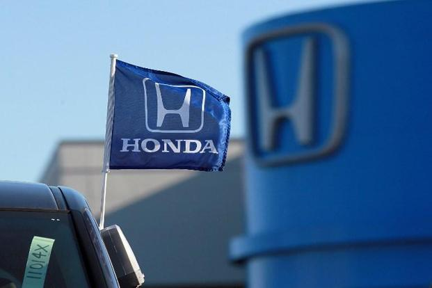 Honda says it has four reports of engine compartment fires due to the problem but no injuries. Photo: AFP