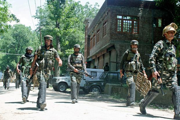 The encounter began after militants opened fire on security forces who were carrying out a search operation in Satoora forest area of Tral, 36 kms from Srinagar. Photo: PTI