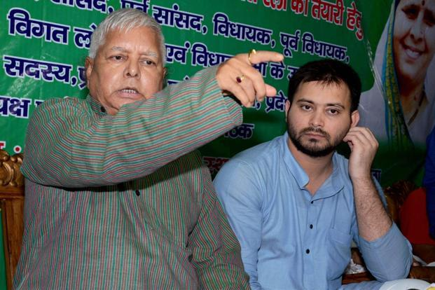 RJD chief Lalu Prasad Yadav made it clear that his son and deputy CM Tejashwi Yadav will not resign. Photo: PTI