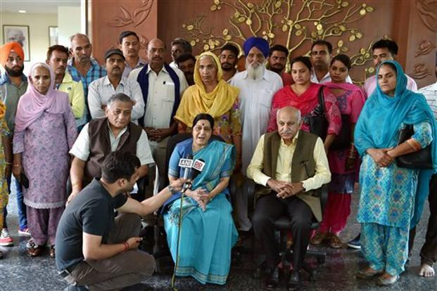 External affairs minister Sushma Swaraj (centre) met family members of 39 Indian men missing in Iraq since June 2014 in Delhi on Sunday. Photo: PTI