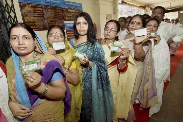 Bihar legislators show their identity cards before casting their votes for the Presidential Election in Patna on Monday. PTI