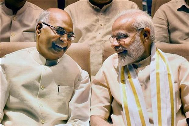 NDA candidate Ram Nath Kovind is set to sweep the Presidential Election 2017 with nearly 70% of electoral college votes. Here, Kovind (left) and Prime Minister Narendra Modi at the NDA meeting in New Delhi on Sunday. PTI