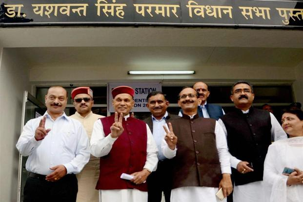 Leader of opposition Prem Kumar Dhumal (3rd left) along with other MLAs after casting their votes in the Presidential Election in Shimla on Monday. PTI