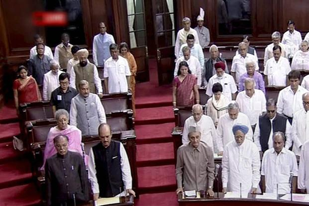 MPs pay tribute to the departed sitting members in Rajya Sabha in New Delhi on the opening day of the monsoon session on Monday. Photo: PTI