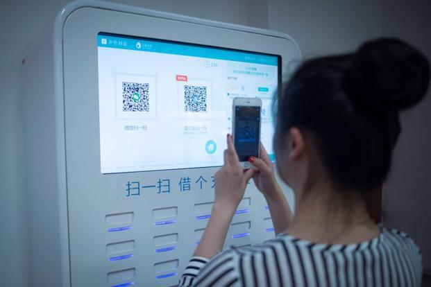 Much of China has become a QR first economy, where codes are now found next to nearly every cash register. Photo: AFP