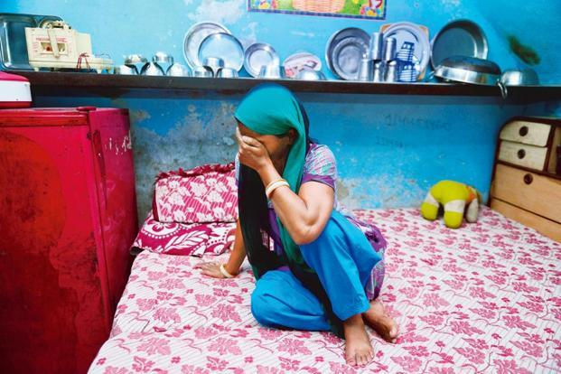 The mother of an eight-year-old rape survivor at her home in Shahbad Dairy. Photograph: Pradeep Gaur/Mint