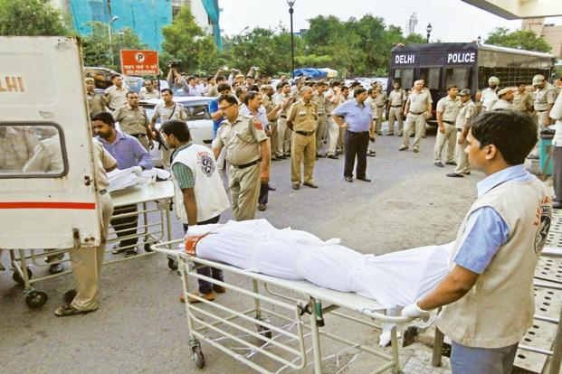 The bodies of gangsters murdered outside Rohini courts in outer Delhi being taken to the morgue. Photograph: Hindustan Times