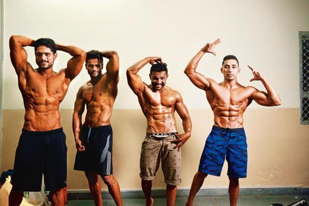 Participants strike a pose at the bodybuilding trials in Meerut. Photographs by Pradeep Gaur/Mint