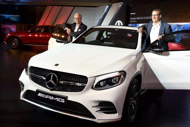 Mercedes Benz India's MD & CEO, Roland Folger, left, and Michael Jopp vice president Sales & Marketing at the launch of Mercedes-AMG GLC43MATIC Coupe in New Delhi on Friday. Photo: PTI
