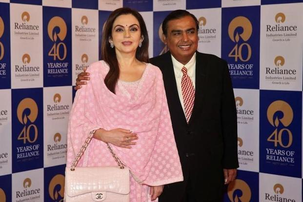 Mukesh Ambani, chairman of Reliance Industries, poses with wife Nita Ambani before addressing the company's annual general meeting in Mumbai on Friday. Photo: Reuters.